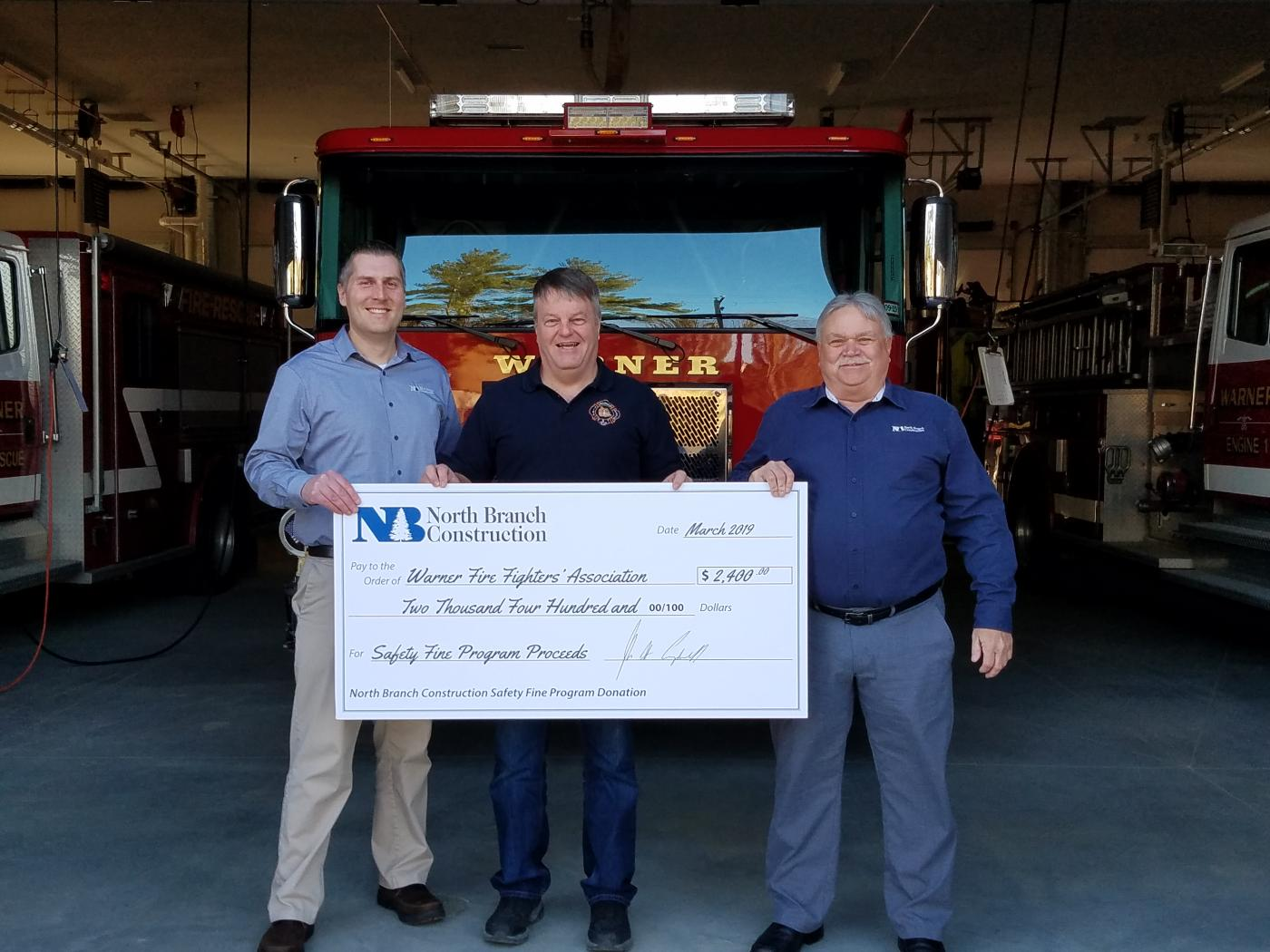 North Branch Construction Presents Safety Fine Program Proceeds at Recently-Completed Warner Fire Station